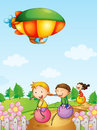 Three kids playing below an airship illustration of Royalty Free Stock Photo