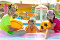 Three kids in pool Royalty Free Stock Image