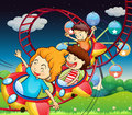 Three kids riding in a roller coaster illustration of the Stock Image
