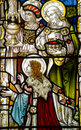Three kings stained glass window historic victorian showing the or wise men presenting their gifts of gold frankincense and myrrh Royalty Free Stock Photos