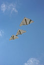 Three kites flying against blue sky Stock Images
