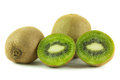 Three kiwi and one cut in half isolated on white background Royalty Free Stock Photos