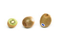 Three kiwis standing lying cut half white background Stock Images
