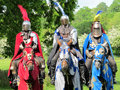 Three knights in shining armor on horseback Royalty Free Stock Photography