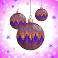 Three knitted christmas balls multicoloured on the background of snowflakes vector illustration eps Royalty Free Stock Image