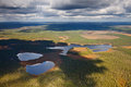 Three lakes in the wooded spaces aerial view of which are on cloudy day Stock Photo