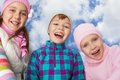 Three laughing kids Stock Images