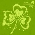 Three leaf clover grunge on green