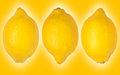 Three lemons on a yellow background Stock Image