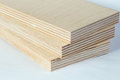 Three light plywood boards stacked Royalty Free Stock Photo