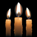 Three Lit Candles Stock Photo