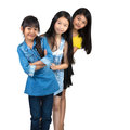 Three little asian girl standing isolated over white Stock Images