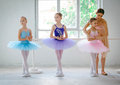 Three little ballerinas with personal ballet teacher in dance studio Royalty Free Stock Photo