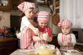 Three little chefs in the kitchen Stock Photos