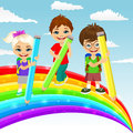 Three little children drawing together a beautiful colorful rainbow with color pencils