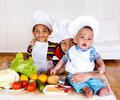Three little cooks Stock Photography