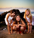 Three little girls in a sunset on the beach Royalty Free Stock Photography