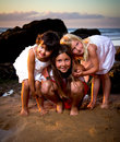 Three little girls in a sunset on the beach Stock Photography