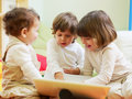 Three little girls using laptop computer Royalty Free Stock Photography
