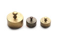 Three little weights antique at white background Stock Photography