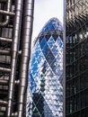 Three london skyscrapers gherkin lloyds willis building the st mary axe flanked by tower and the in the city of england Royalty Free Stock Photography