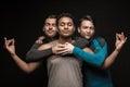 Three male friends posing on black Royalty Free Stock Photo