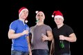 Three man wearing santa hat Stock Photography