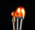 Three matches burning at different rates Royalty Free Stock Image