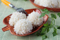 Three meat balls with rice on bamboo plates Stock Images