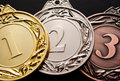 Three medals for prizes closeup Royalty Free Stock Photo