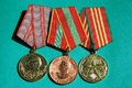 Three medals of the soviet union sociology on a green background Stock Photo