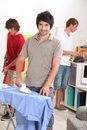 Three men doing housework together Royalty Free Stock Photo