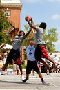 Three men fight for rebound in outdoor street basketball tournament athens ga usa august young a while playing a on held on the Stock Image