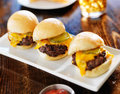 Three mini burger sliders in a row photo of Royalty Free Stock Image
