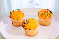 Three Miniture Yellow Cupcakes Royalty Free Stock Image