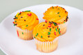 Three Miniture Yellow Cupcakes Stock Image
