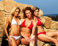 Three models in bikinis Royalty Free Stock Photos