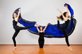 Three modern ballerinas dancing with huge colorful flying fabric Royalty Free Stock Photo