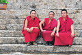 Three monks in tibet knock a gong monk sangpi temple xiangcheng country sichuan Stock Photography