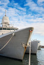 Three naval ships moored in dock Stock Photo