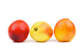 Three nectarines in a row isolated on white background Royalty Free Stock Images