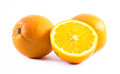 Three nicely colored oranges on a white background - front and back cut in half Royalty Free Stock Photo