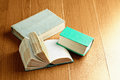 Three old books over wooden surface Stock Photography