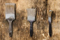 Three old brushes on a surface of old and dirty Royalty Free Stock Photo