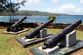 Three old canons at fort jekabs with great courland bay in the background Royalty Free Stock Photos
