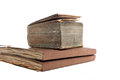 Three old vintage books worn aged pages stacked top each other isolated white Stock Photo