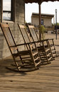 Three old West town empty rocking chairs Royalty Free Stock Image