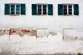 Three old windows on old white wall as background close up Royalty Free Stock Photography