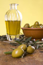 Three olives with an olive oil and bowl with olives Royalty Free Stock Photo