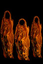 Three Orange Halloween Ghosts or Ghouls Stock Photos
